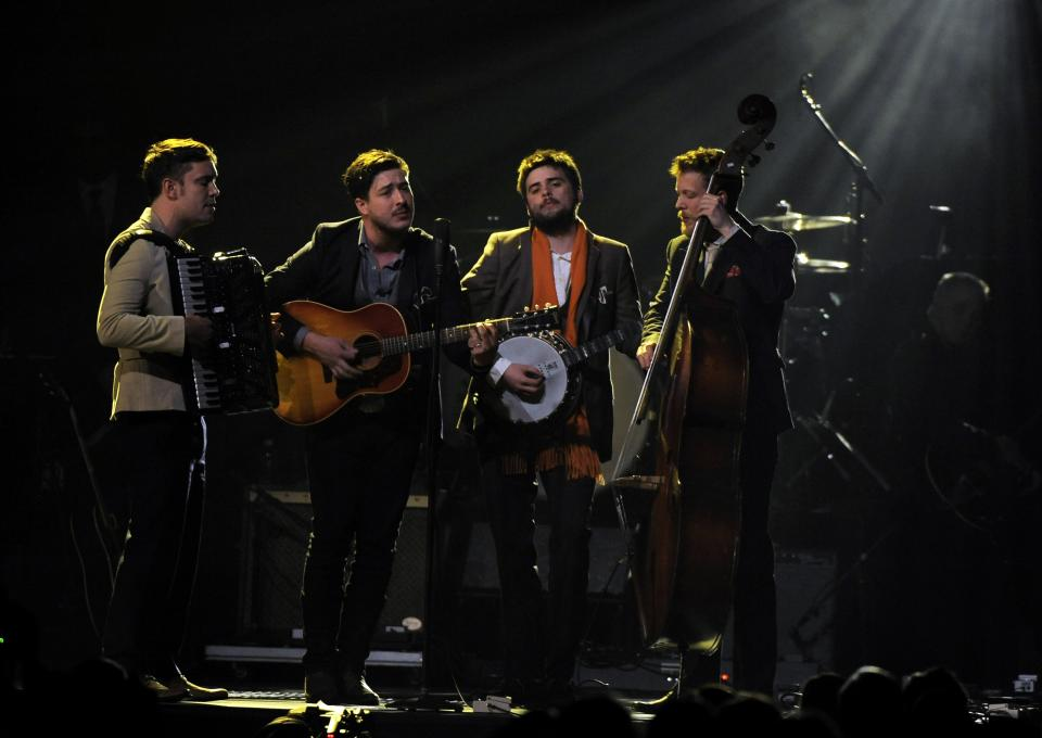 "Musical group Mumford & Sons perform ""I'm on Fire"" onstage at the MusiCares Person of the Year tribute honoring Bruce Springsteen at the Los Angeles Convention Center on Friday Feb. 8, 2013, in Los Angeles. (Photo by Chris Pizzello/Invision/AP)"