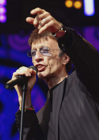FILE This Saturday Aug. 15, 2009 file photo Britain&#39;s Robin Gibb performs in the park of Ledreborg Castle near Roskilde, Denmark. British media reports said Saturday April 14, 2012 former Bee Gee Robin Gibb is gravely ill with pneumonia in a London hospital. The Sun newspaper reported Saturday that 62-year-old Gibb is in a coma, citing a family friend. (AP Photo/Polfoto,Jens Dige) DENMARK OUT
