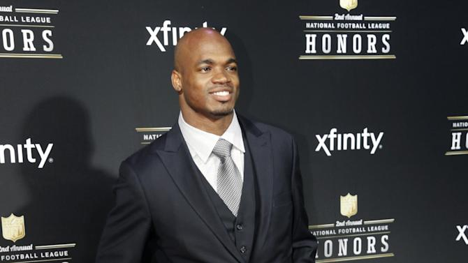 Adrian Peterson of the Minnesota Vikings arrives at the 2nd Annual NFL Honors on Saturday, Feb. 2, 2013 in New Orleans. (Photo by AJ Mast/Invision/AP)