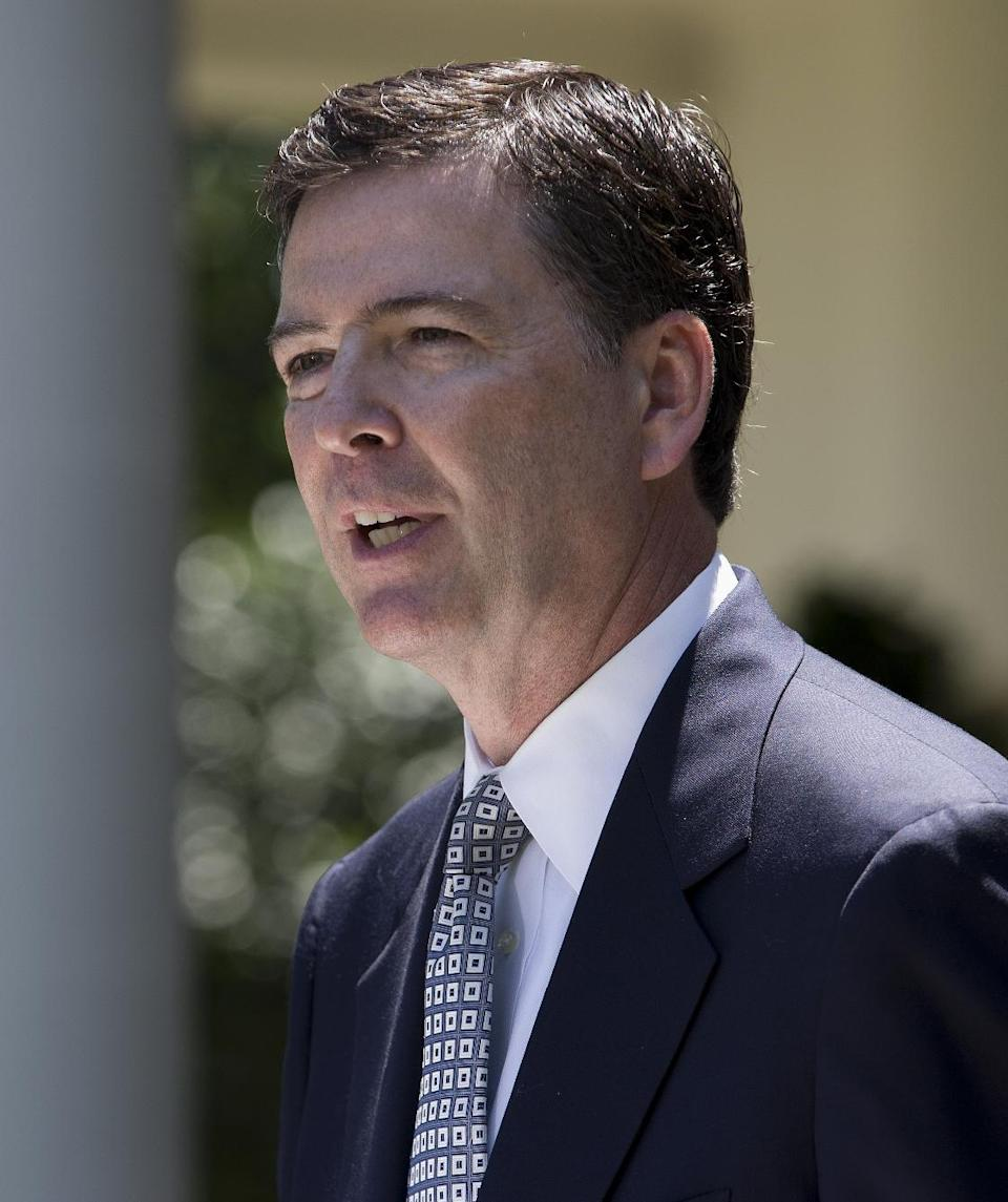 James Comey, a senior Justice Department official under President George W. Bush, speaks in the Rose Garden of the White House in Washington, Friday, June 21, 2013, after President Barack Obama announced he would nominate Comey to replace Robert Mueller as FBI director. (AP Photo/Evan Vucci)