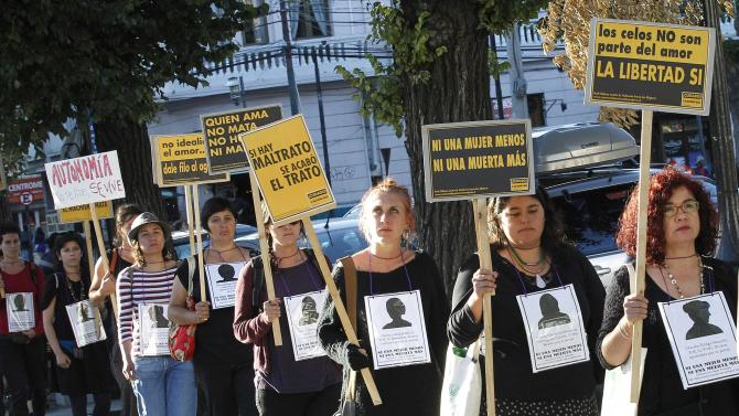 Members of feminist organizations hold signs during a rally in Valparaiso