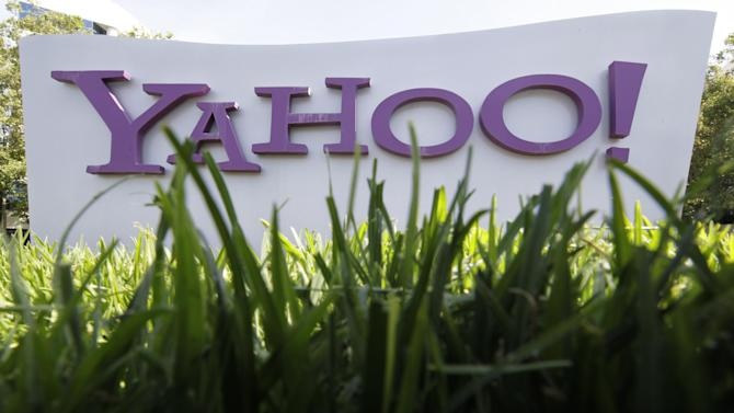 A Yahoo sign stands outside the company's offices in Santa Clara, Calif., Monday, May 20, 2012. Struggling Internet company Yahoo Inc. has secured a lifeline after agreeing to sell half of its prized stake in Chinese e-commerce group Alibaba for about $7.1 billion, with most of the cash going to shareholders. (AP Photo/Paul Sakuma)