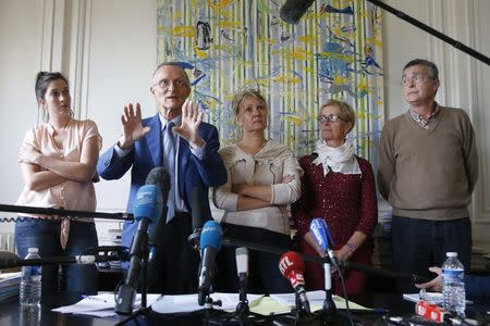 Patrick Baudouin, lawyer of the families of the seven French Trappists monks who were kidnapped from their monastery and killed in May 1996 in Tibhirine, Algeria, speaks during a news conference at his office in Paris