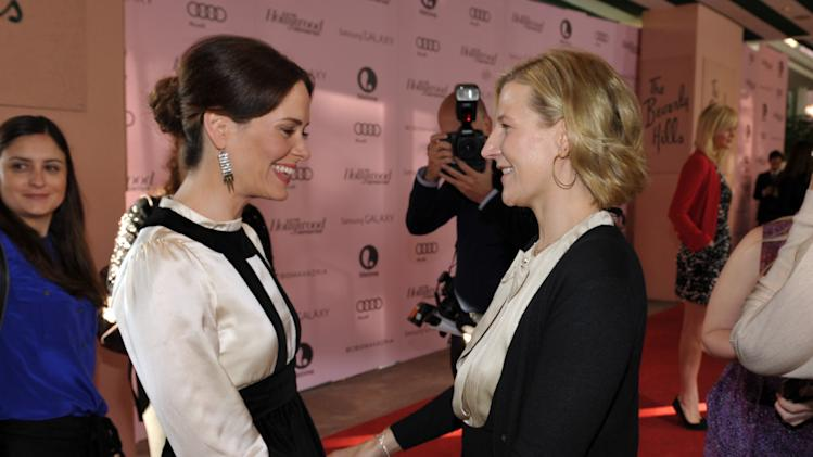Actress Sarah Paulson, left, and President of Time Warner's HBO Entertainment, Sue Naegle arrive at The Hollywood Reporter's 21st Annual Women in Entertainment Power 100 breakfast presented by Lifetime on Wednesday, Dec. 5, 2012 in Beverly Hills, Calif.  (Photo by John Shearer/Invision for The Hollywood Reporter/AP Images)