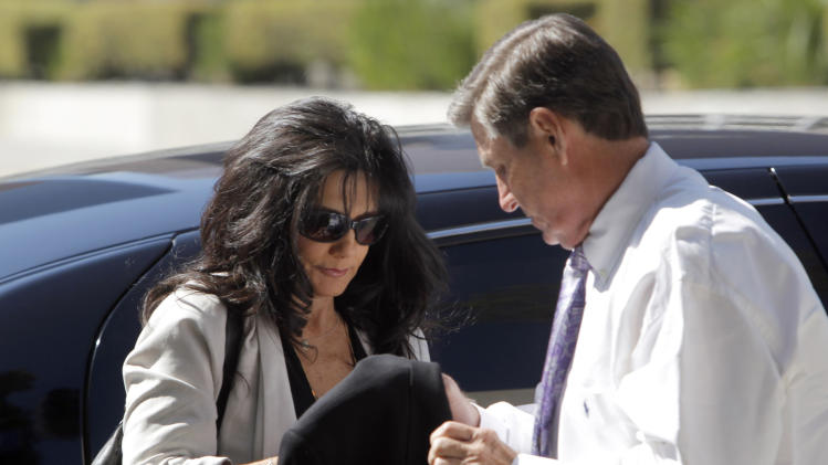 Britney Spears parents, Lynne Spears, left, and Jamie Spears arrive at court Friday Oct. 19, 2012 in Los Angeles. Jurors have been selected to hear a case against Britney Spears' parents that will focus heavily on events that led up to her public breakdown. (AP Photo/Nick Ut)