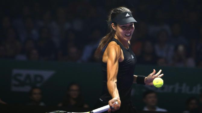 Ana Ivanovic of Serbia plays a shot against Serena Williams of the U.S. during their WTA Finals singles tennis match in Singapore
