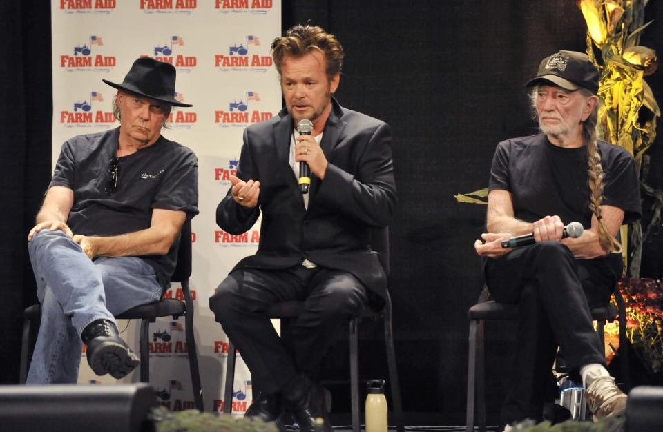 Neil Young, left, John Mellencamp, center, and Willie Nelson, right, give a news conference prior to the start of the Farm Aid 2013 concert at Saratoga Performing Arts Center in Saratoga Springs, N.Y., Saturday, Sept. 21, 2013.