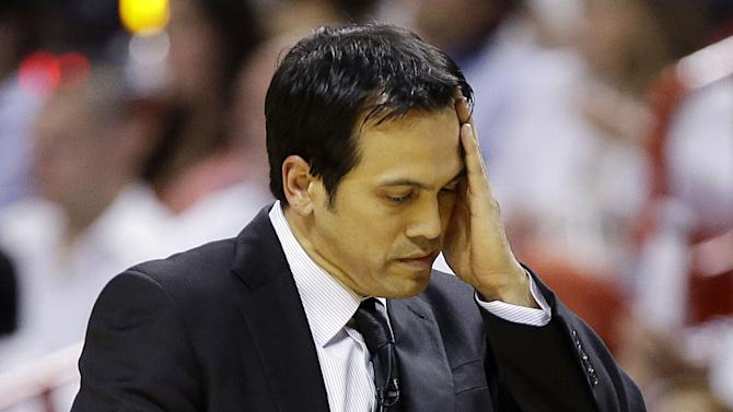 Miami Heat head coach Erik Spoelstra wipes his face during the first half of Game 2 in their NBA basketball Eastern Conference finals playoff series against the Indiana Pacers, Friday, May 24, 2013, in Miami. (AP Photo/Lynne Sladky)