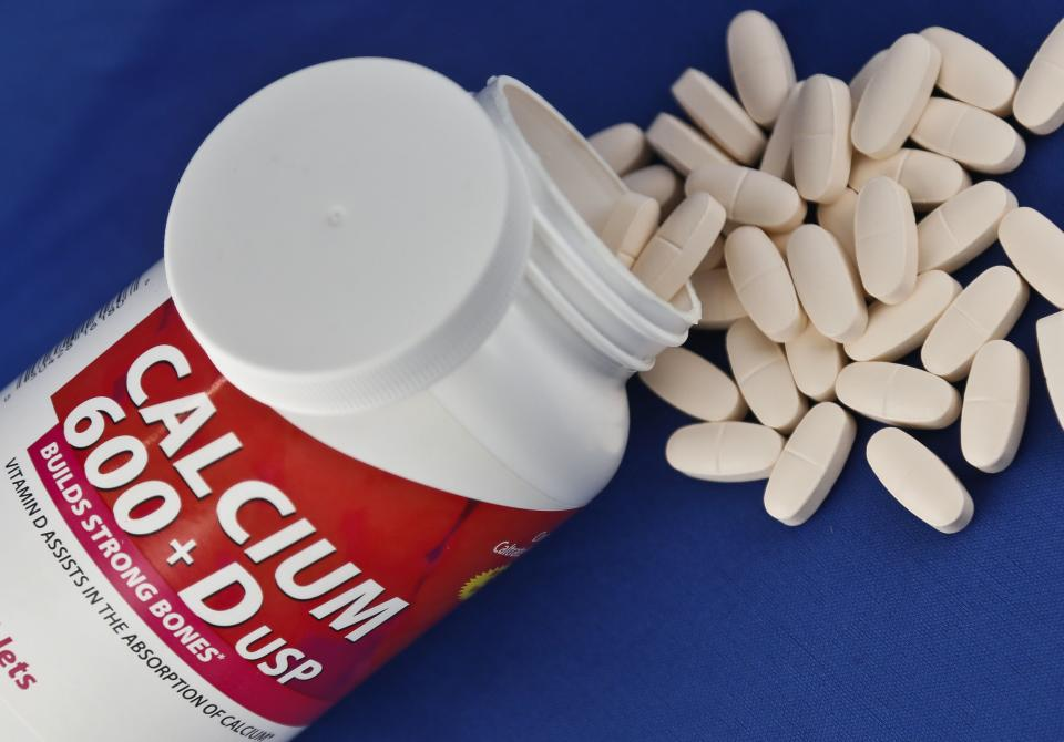A photo illustration shows a container of over the counter calcium supplements, Monday, Feb. 25, 2013. A government advisory group says the relatively low doses found in today's dietary supplements don't prevent broken bones in women after menopause. (AP Photo/Bebeto Matthews)