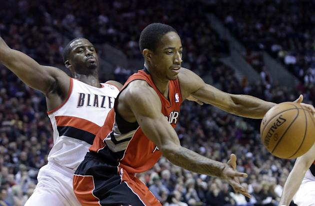 Toronto Raptors guard DeMar DeRozan, right, pulls in a loose ball as Portland Trail Blazers guard Wesley Matthews defends during the first half of an NBA basketball game in Portland, Ore., Saturday, F