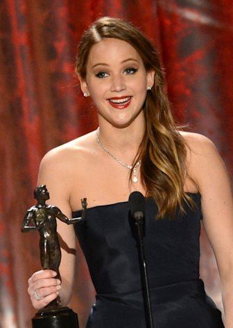 Jennifer Lawrence accepts the award for Outstanding Performance by a Female Actor in a Leading Role for 'Silver Linings Playbook' onstage during the 19th Annual Screen Actors Guild Awards held at The Shrine Auditorium on January 27, 2013 (Photo by Getty Images)  --
