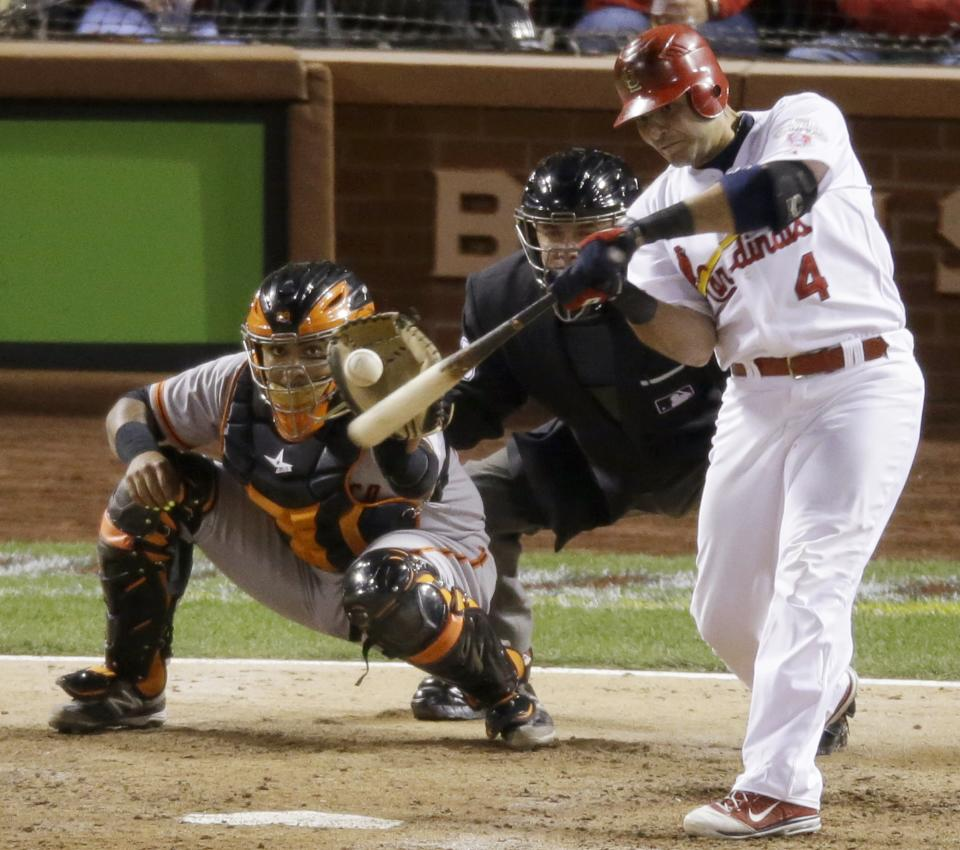 St. Louis Cardinals' Yadier Molina hits a run-scoring double during the seventh inning of Game 4 of baseball's National League championship series against the San Francisco Giants Thursday, Oct. 18, 2012, in St. Louis. (AP Photo/Mark Humphrey)