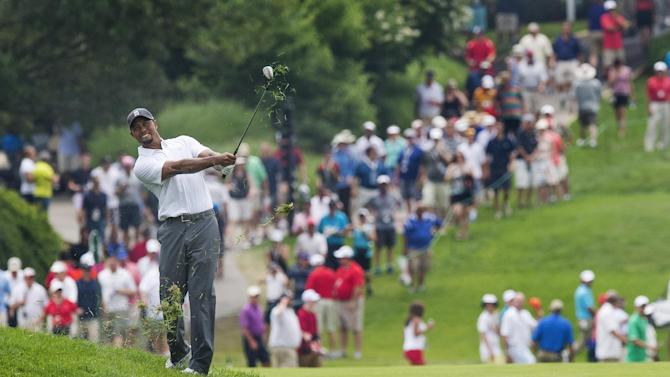 US golfer Tiger Woods swings from the rough during the second round of the National at Congressional Country Club in Bethesda, Maryland, on June 27, 2014