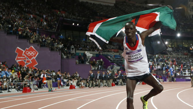 Kenya's Ezekiel Kemboi celebrates winning gold in the men's 3000-meter steeplechase during the athletics in the Olympic Stadium at the 2012 Summer Olympics, London, Sunday, Aug. 5, 2012. (AP Photo/Matt Dunham)