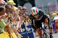 Fans applaud Switzerland&#39;s Fabian Cancellara during the Tour de France on July 9. Cancellara said Monday he will fight through the pain to defend his Olympic time trial crown on Wednesday. He crashed heavily while in contention for a medal in the men&#39;s road race on Saturday injuring his shoulder but crucially avoiding fracturing his collarbone