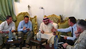 Dr. Derrin Smith (far left) meets with Sheikh Ahmed abu Risha, head of the Anbar Awakening movement.
