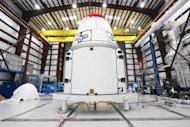 This Jan. 12, 2013 photo provided by NASA shows the Dragon spacecraft inside a processing hangar at Cape Canaveral Air Force Station in Cape Canaveral, Fla. where teams had just installed the spacecraft's solar array fairings. The California company known as SpaceX is scheduled to launch its unmanned Falcon rocket on Friday morning, March 1, 2013, carrying a Dragon capsule containing more than a ton of food, tools, computer hardware and science experiments. (AP Photo/NASA, Kim Shiflett)