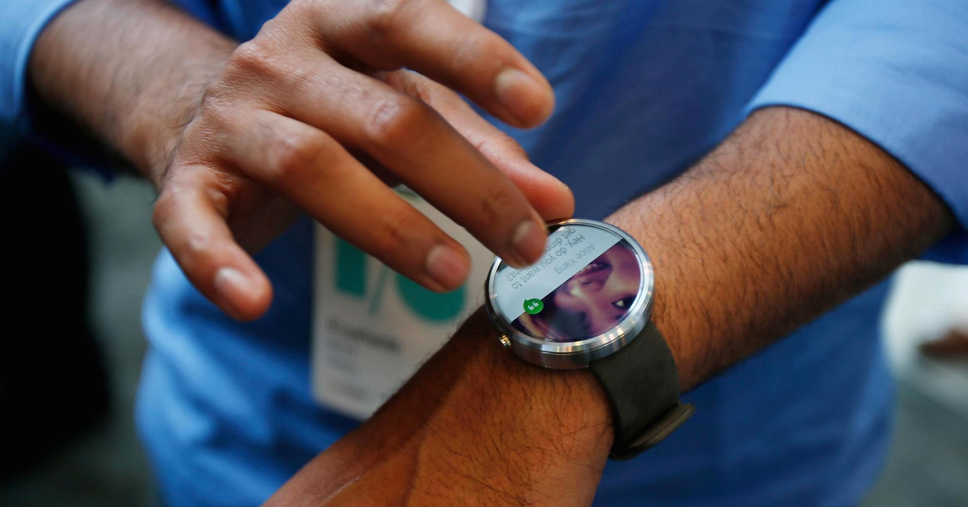 Google expands Android Wear watch platform to iOS