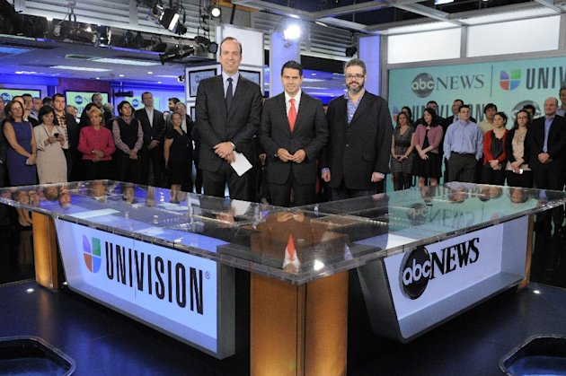 In this image released by ABC, ABC News president Ben Sherwood , left, Univision Networks president Cesar Conde, center, and Univision News president Isaac Lee pose as they announce the joint venture between ABC News and Univision News, Monday, May 7, 2012 in New York. (AP Photo/ABC, Lorenzo Bevilaqua)