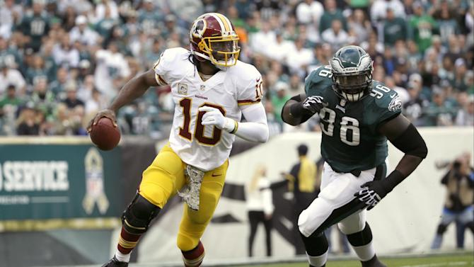 Redskins' RG3 clears air with Moss, coaches