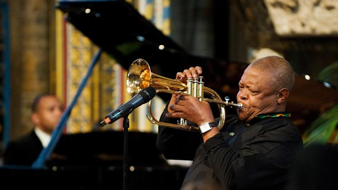South African musician Hugh Masekela performs during the Observance for Commonwealth Day service at Westminster Abbey in central London, Monday March 12, 2012.  Queen Elizabeth II attended the service as head of the commonwealth of 54 member nations.  (AP PHOTO / LEON NEAL)