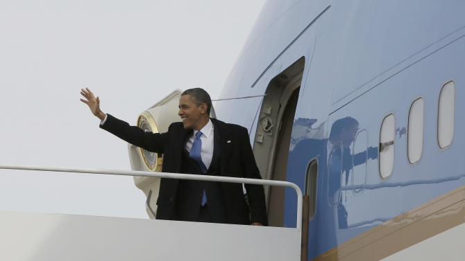 President Barack Obama waves as he prepares to board Air Force One before his departure from Andrews Air Force Base, Monday, Feb., 4, 2013, enroute to Minnesota. (AP Photo/Pablo Martinez Monsivais)