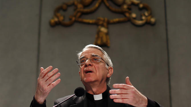 Vatican spokesman Father Lombardi talks to reporters during a news conference at the Vatican