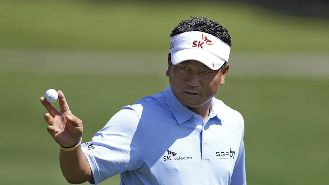 K.J. Choi, of South Korea, holds up his golf ball after putting out on the seventh hole during the first round of the Tampa Bay Championship golf tournament Thursday, March 14, 2013, in Palm Harbor, Fla. (AP Photo/Chris O'Meara)