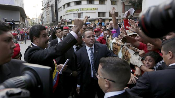 Venezuela's President Nicolas Maduro, (2nd L),salutes his supporters after his arrive at the national assembly in Caracas