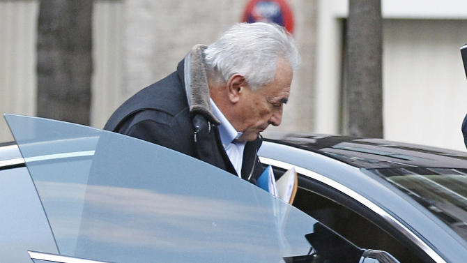 Former International Monetary Fund leader Dominique Strauss-Kahn enters his car after leaving his apartment building in Paris, Monday Dec. 10, 2012. The outcome of a New York City hotel housekeeper's sexual assault lawsuit against  Dominique Strauss-Kahn will be settled Monday in a New York court. (AP Photo/Remy de la Mauviniere)
