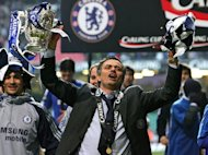 Jose Mourinho celebrates Chelsea's League Cup triumph at The Millennium Stadium in Cardiff on February 25, 2007. Mourinho looks set to be welcomed back to Chelsea with open arms, but his reputation has been sullied during his three-year stint at Real Madrid and he will return to Stamford Bridge with several thorny issues to address