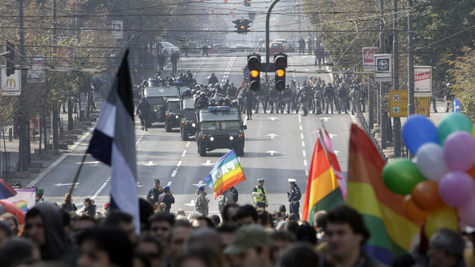 FILE - In this Sunday, Oct. 10, 2010 file photo, Serbian riot police gather to protect a gay pride parade as it moves along a street in Belgrade, Serbia. Riot police later clashed with hundreds of far-right protesters who tried to disrupt the parade. Serbia's police on Wednesday, Oct. 3, 2012, banned a gay pride march in Belgrade planned for the weekend, citing security concerns but also complying with a request from Serbia's Christian Orthodox church. (AP Photo/Darko Vojinovic, File)