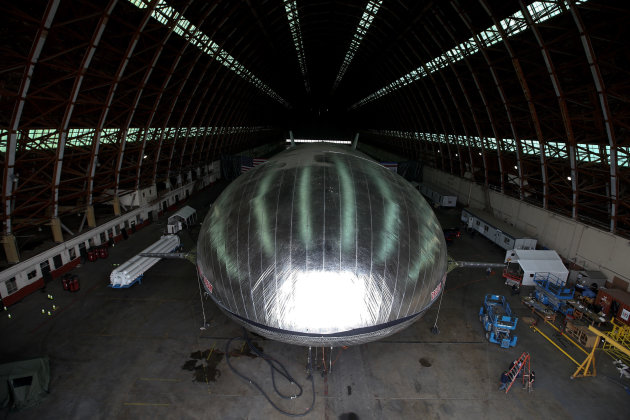 The Aeroscraft airship, a high-tech prototype airship, is seen in a World War II-era hangar in Tustin, Calif., Thursday, Jan. 24, 2013. Work is almost done on a 230-foot rigid airship inside a blimp hangar at a former military base in Orange Co. The huge cargo-carrying airship is has shiny aluminum skin and a rigid, 230-foot aluminum and carbon fiber skeleton. (AP Photo/Jae C. Hong)