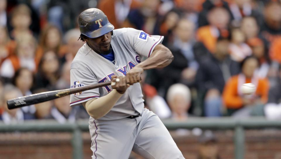 Texas Rangers' Vladimir Guerrero hits a run-scoring single off San Francisco Giants' Tim Lincecum during the first inning of Game 1 of baseball's World Series Wednesday, Oct. 27, 2010, in San Francisco. (AP Photo/David J. Phillip)