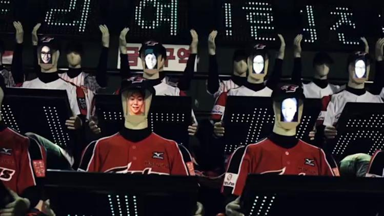 BASEBALL TEAM FILLS SEATS WITH ROBOTS