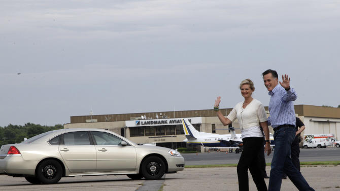 Republican presidential candidate, former Massachusetts Gov. Mitt Romney, and his wife Ann wave at reporters as they arrive in Norfolk, Va.,  Friday, Aug. 10, 2012. Romney will announce his running mate Saturday morning Aug. 11, 2012 in Norfolk, Va., his campaign said Friday night. (AP Photo/Mary Altaffer)