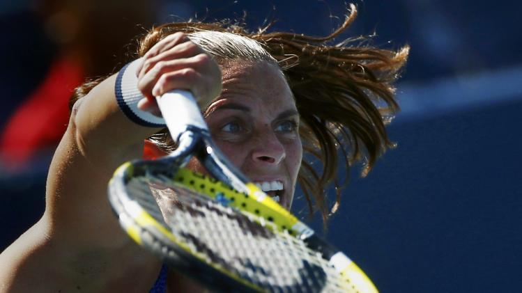 Roberta Vinci of Italy serves to Peng Shuai of China during their match at the 2014 U.S. Open tennis tournament in New York