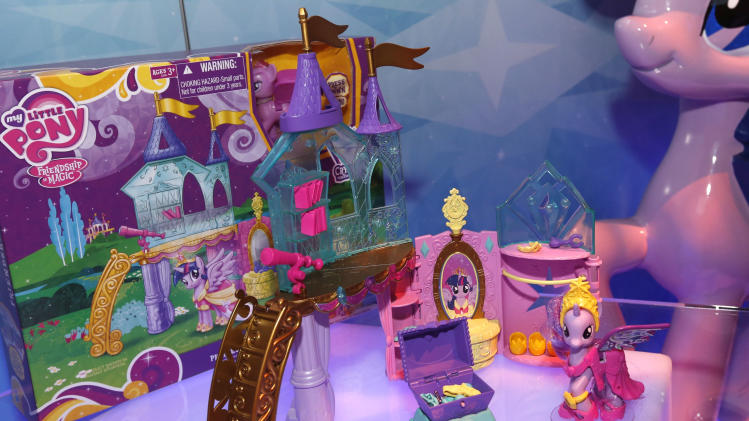 """IMADE DISTRIBUTED FOR HASBRO - The MY LITTLE PONY CRYSTAL PRINCESS PALACE playset is displayed in Hasbro's showroom at the American International Toy Fair, Sunday, Feb. 10, 2013, in New York.  The CRYSTAL PRINCESS PALACE playset, available at retail Fall 2013, is inspired by the upcoming coronation of TWILIGHT SPARKLE in the animated series """"My Little Pony Friendship is Magic,"""" created by Hasbro Studios and airing on the Hub TV Network in the US. (Photo by Jason DeCrow/Invision for Hasbro/AP Images)"""