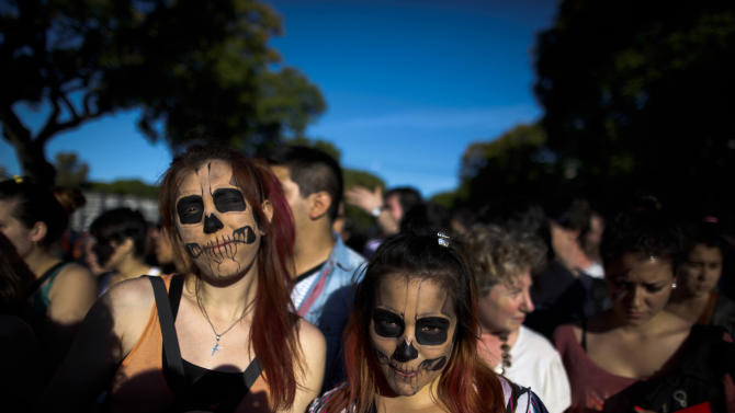 """Lady Gaga fans wait to enter the stadium where the U.S. pop star will perform a concert, in Buenos Aires, Argentina, Friday, Nov. 16, 2012. The Latin American leg of her, """"Born This Way Ball Tour,"""" is coming to an end but not before stopping in Chile, Peru and Paraguay. (AP Photo/Natacha Pisarenko)"""