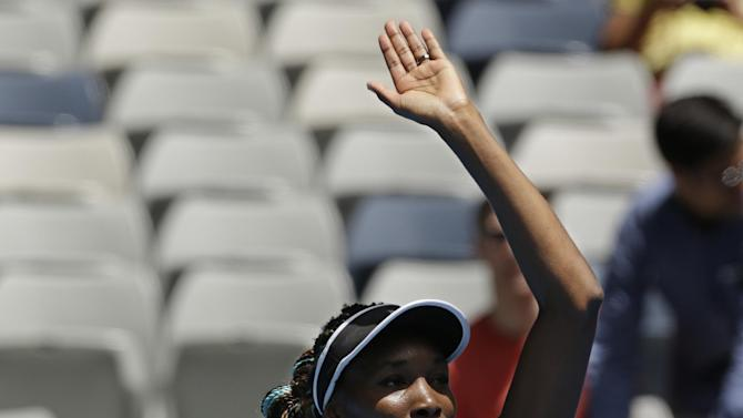 Venus Williams of the US waves after defeating Kazakstan's Galina Voskoboeva during their first round match at the Australian Open tennis championship in Melbourne, Australia, Monday, Jan. 14, 2013. (AP Photo/Rob Griffith)
