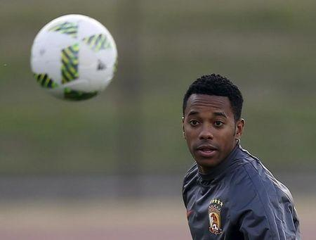 oGuangzhou Evergrande's Robinho eyes the ball during a training session ahead of their Club World Cup semi-final soccer match against Barcelona in Yokohama, Japan