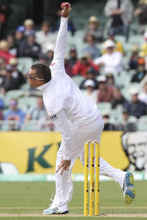 England's Graeme Swann bowls against Australia during their second Ashes cricket test match in Adelaide, Australia, Thursday, Dec. 5, 2013
