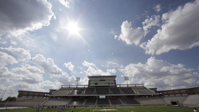 The sun shines over the  $60 million new football stadium at Allen High School Tuesday, Aug. 28, 2012 in Allen, Texas.  Allen High School northeast of Dallas christens the stadium Friday night with a matchup against defending state champion Southlake Carroll. While other school districts are struggling to retain teachers and keep classroom sizes down, Allen voters approved a $119 million bond issue that pays for the stadium and other district facilities. (AP Photo/LM Otero)