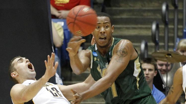 South Florida forward Ron Anderson Jr. (1) passes the ball out against California forward Harper Kamp (22) in the first half of an NCAA tournament first-round college basketball game, Wednesday, March 14, 2012, in Dayton, Ohio. (AP Photo/Skip Peterson)