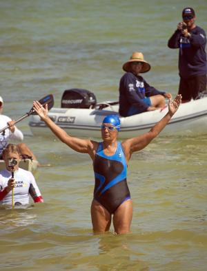 In this photo provided by the Florida Keys News Bureau, endurance swimmer Diana Nyad waves to her team after swimming a short distance from a support boat to shore in Key West, Fla., Tuesday, Aug. 21, 2012. Nyad failed in a fourth attempt to complete a swim across the Florida Straits from Cuba to the Florida Keys. (AP Photo/Florida Keys News Bureau, Andy Newman)
