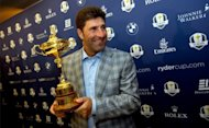 Jose Maria Olazabal poses with the Ryder Cup at Heathrow Airport on Tuesday. The Ryder Cup-winning captain says he will not lead Europe into the next edition in 2014, after steering the team to a famous against-the-odds victory last weekend