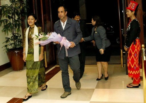 UN Human Rights Special Envoy Tomas Ojea Quintana (C) arrives at a hotel in Yangon