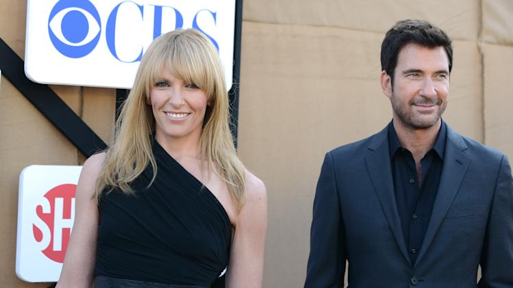 Toni Collette, left, and Dylan McDermott arrive at the CBS, CW and Showtime TCA party at The Event on Monday, July 29, 2013 in Beverly Hills, Calif. (Photo by Jordan Strauss/Invision/AP)