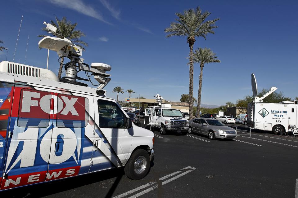 Television trucks park next to at a 4 Sons Food Store where one of the winning tickets in the $579.9 million Powerball jackpot was purchased, Nov. 29, 2012, in Fountain Hills, Ariz.(AP Photo/Ross D. Franklin)