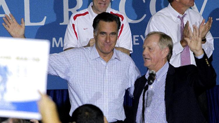 FILE - This Sept. 26, 2012 file photo shows golf legend Jack Nicklaus, right,welcoming Republican presidential candidate, former Massachusetts Gov. Mitt Romney to the stage during a campaign rally in Westerville, Ohio. Whatever their political beliefs, some artists perform an age-old ritual: warming up the crowd before a political rally, generating enthusiasm and all-important buzz for events that otherwise could be overlooked in a crowded news cycle. For politicians _ even those as well known as President Barack Obama and Romney _  celebrity warm-up acts can provide validation by taking them out of the political realm into popular culture, said Darrell West, director of governance studies at the Brookings Institution think tank in Washington.  (AP Photo/Jay LaPrete, File)